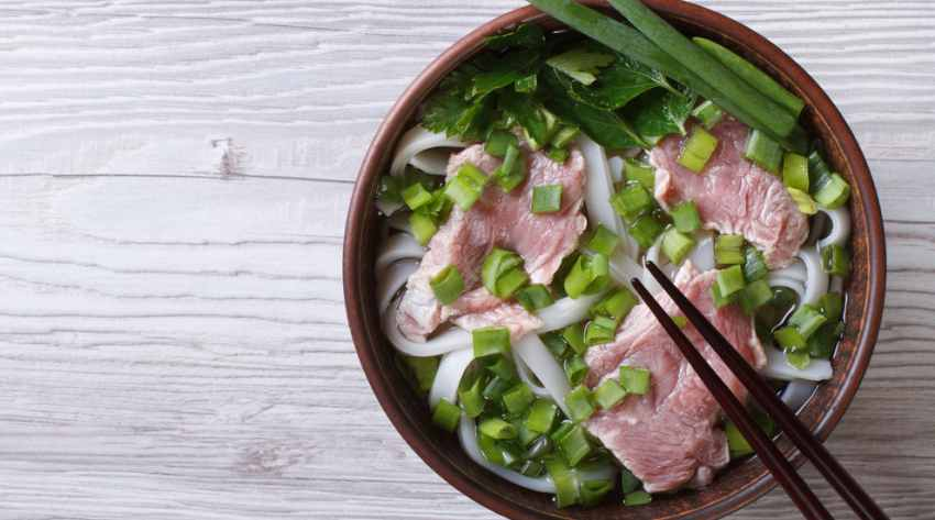 Vietnamese Pho Bo soup with beef and rice noodles