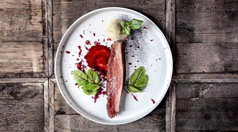 hunting-the-duck-grilled-duck-breast-served-with-pomegranate-sauce-at-w-restaurant